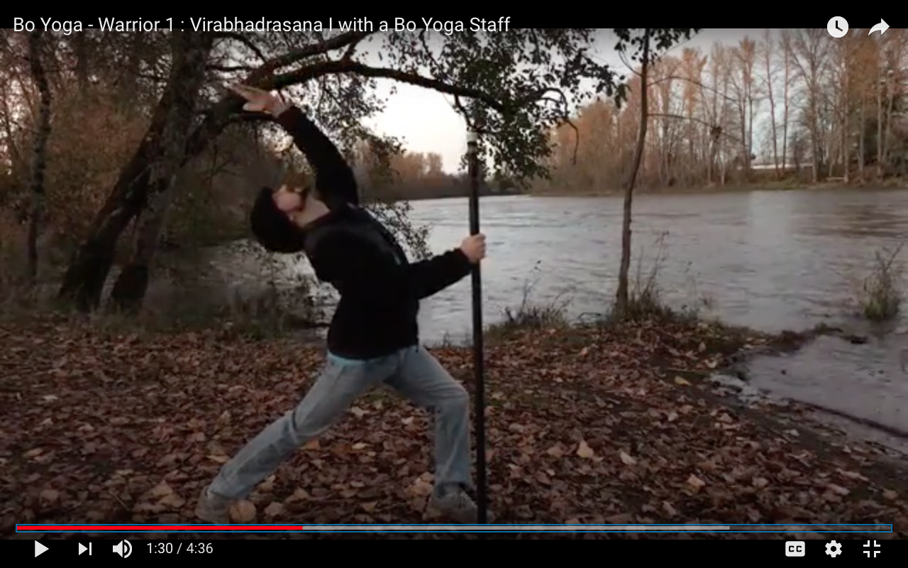 Bo Yoga - Warrior 1 : Virabhadrasana I with a Bo Yoga Staff